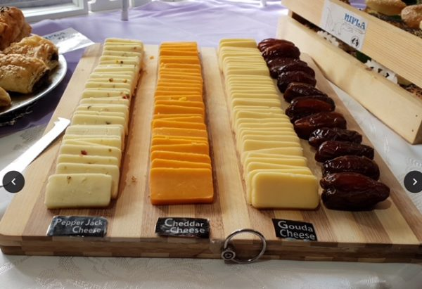 A delicious kosher cheese and date board by Nifla Kosher Catering in Melbourne